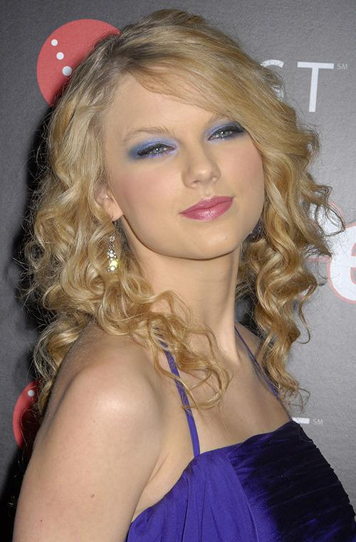 """Taylor Swift illustrates beautifully the risks of wearing blue eye shadow. """"Although it can be done in a way that's edgy (a deeper matte shade paired with winged black liner), it's not easy to pull off without looking very 80s and dated,"""" says beauty editor Bobbi Brown."""