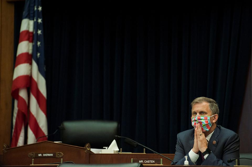 Rep. Sean Casten, D-Ill, listens as  U.S. Securities and Exchange Commission Chairman Jay Clayton, testifies before a House Committee on Financial Services hearing entitled