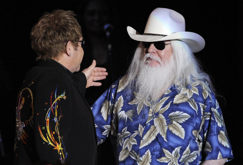 FILE - In this Nov. 3, 2010, file photo, Elton John, left, greets Leon Russell on the stage during their joint concert at the Hollywood Palladium in Los Angeles. Russell, who sang, wrote and produced some of rock 'n' roll's top records, has died. (AP Photo/Chris Pizzello, File)