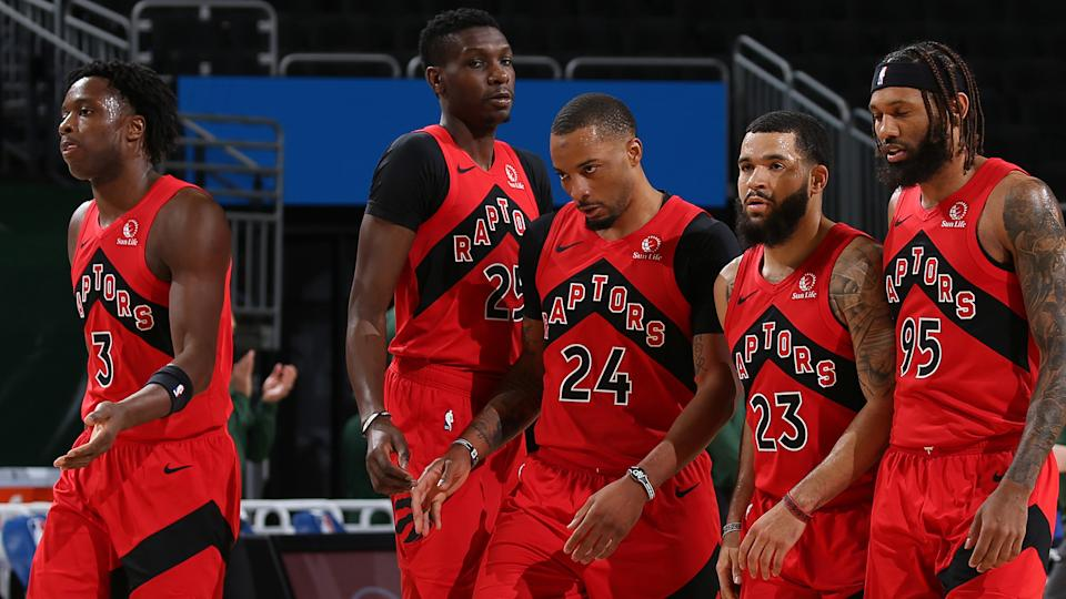 MILWAUKEE, WI - FEBRUARY 18: The Toronto Raptors walk off the court during the game against the Milwaukee Bucks on February 18, 2021 at the Fiserv Forum Center in Milwaukee, Wisconsin. NOTE TO USER: User expressly acknowledges and agrees that, by downloading and or using this Photograph, user is consenting to the terms and conditions of the Getty Images License Agreement. Mandatory Copyright Notice: Copyright 2021 NBAE (Photo by Gary Dineen/NBAE via Getty Images)