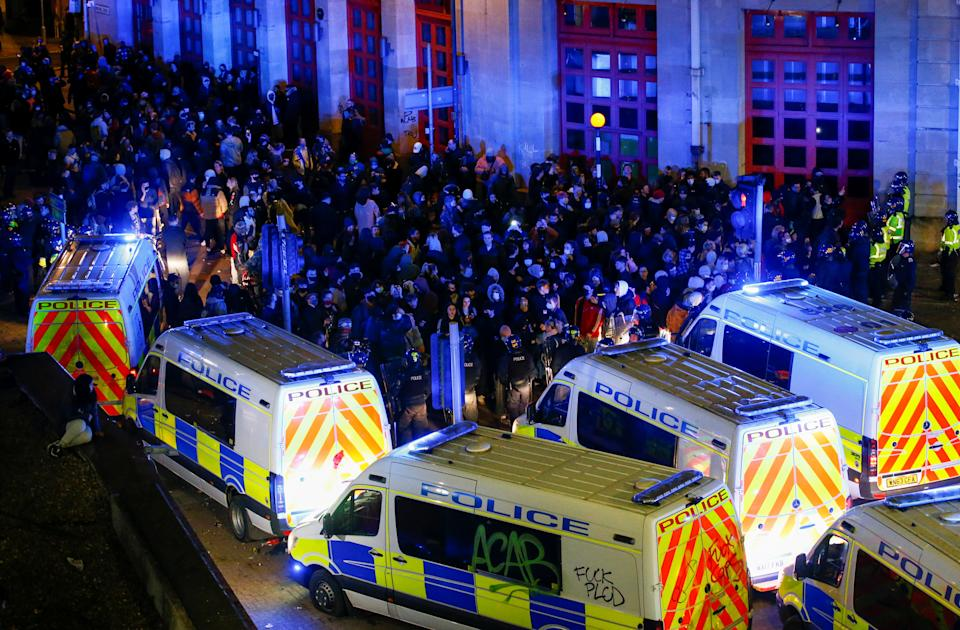 <p>SENSITIVE MATERIAL. THIS IMAGE MAY OFFEND OR DISTURB Demonstrators gather outside a police station during a protest against a new proposed policing bill, in Bristol, Britain, March 21, 2021. REUTERS/Peter Cziborra</p>