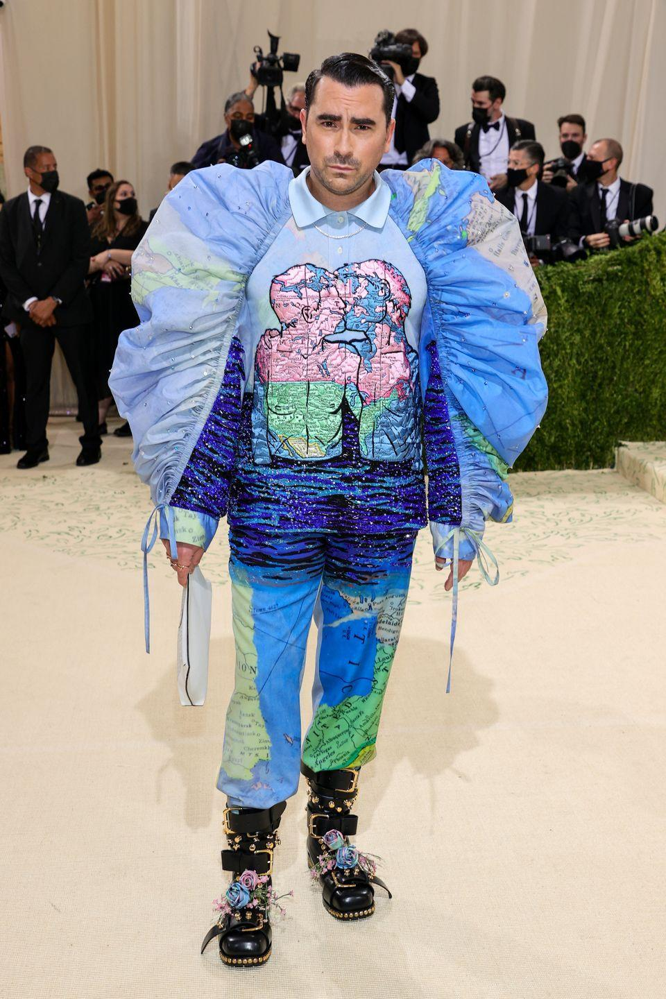 <p>Never afraid to take a sartorial risk, Dan Levy lived up to all of the night's over the top expectations with this map-printed look. </p>