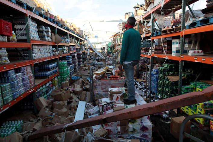 A man stands inside a destroyed supermarket by Hurricane Maria in Salinas, Puerto Rico, on Friday. (Photo: Alvin Baez/Reuters)