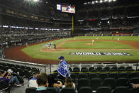 Fans watch during the sixth inning in Game 1 of the baseball World Series between the Los Angeles Dodgers and the Tampa Bay Rays Tuesday, Oct. 20, 2020, in Arlington, Texas. (AP Photo/Eric Gay)