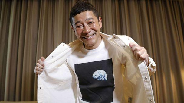 PHOTO: Japanese billionaire Yusaku Maezawa poses with his T-shirt bearing an image of Earth during an interview with Reuters in Tokyo, March 3, 2021. (Kim Kyung-hoon/Reuters)