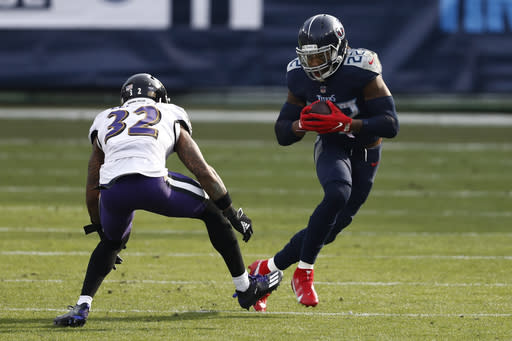 Tennessee Titans running back Derrick Henry (22) carries the ball against Baltimore Ravens free safety DeShon Elliott (32) in the second half of an NFL wild-card playoff football game Sunday, Jan. 10, 2021, in Nashville, Tenn. (AP Photo/Wade Payne)