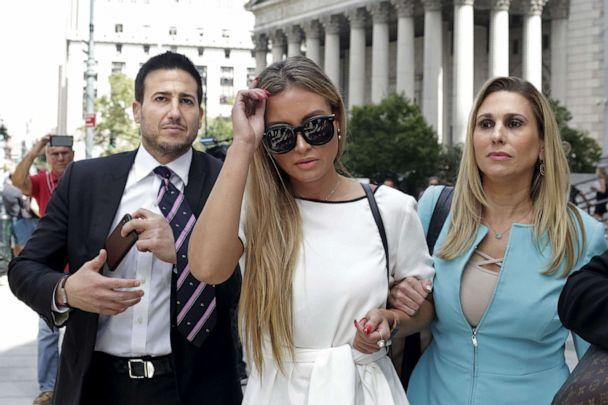 PHOTO: Jennifer Araoz, center, one of Jeffrey Epstein's alleged victims, and her attorney finish speaking to the press outside the Federal Court in New York, Aug. 27, 2019. (Yana Paskova/AFP via Getty Images, FILE)