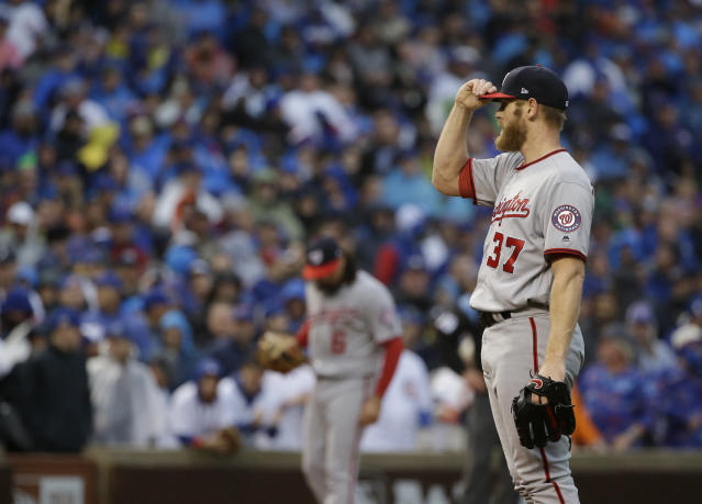 Washington Nationals starting pitcher Stephen Strasburg (37) adjusts his cap during the second inning of Game 4 of baseball's National League Division Series against the Chicago Cubs, Wednesday, Oct. 11, 2017, in Chicago. (AP Photo/Nam Y. Huh)