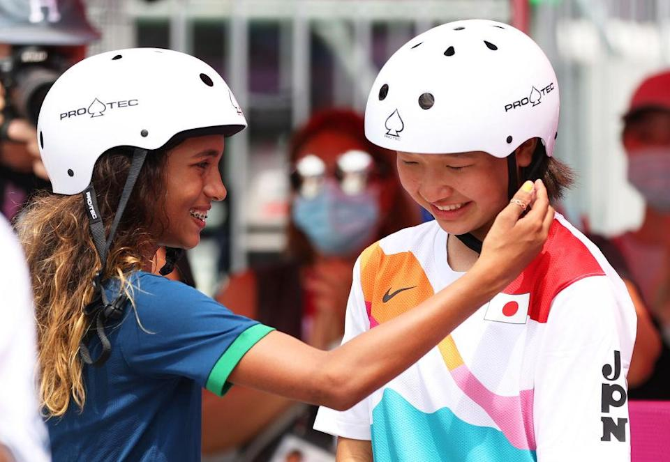 """Rayssa Leal puts her hand up to the face of Momiji Nishiya during the Women's Street Final at the Tokyo 2020 Olympic Games on July 26.<span class=""""copyright"""">Patrick Smith—Getty Images</span>"""
