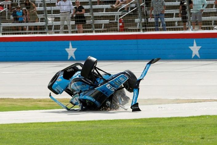 American Conor Daly's Carlin Chevrolet flips over in a multi-car crash at the start of the second race of IndyCar's Texas Motor Speedway double header. He escaped without serious injury