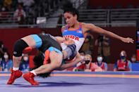 <p>Cuba's Yusneylis Guzman Lopez (red) wrestles China's Sun Yanan in their women's freestyle 50kg wrestling early round match during the Tokyo 2020 Olympic Games at the Makuhari Messe in Tokyo on August 6, 2021. (Photo by Jack GUEZ / AFP)</p>