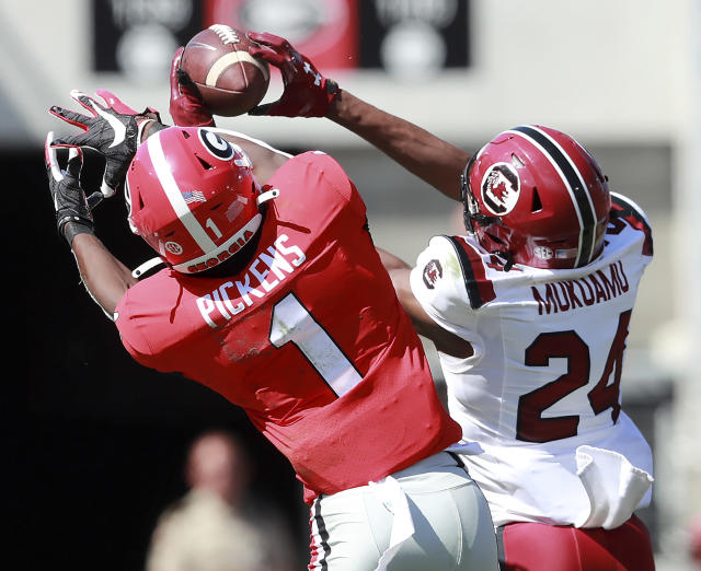 South Carolina defensive back Israel Mukuamu intercepts a pass intended for Georgia wide receiver George Pickens during the second quarter of an NCAA college football game, Saturday, Oct., 12, 2019, in Athens, Ga. Mukuamu returned the ball for a touchdown. (Curtis Compton/Atlanta Journal-Constitution via AP)