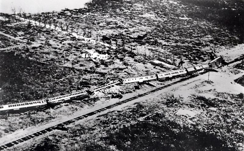 """FILE - This September 1935 file photo shows the wreckage of an 11-car passenger train that was derailed by a Labor Day hurricane in the Florida Keys. The Hurricane Center says no wind measurements were available from the core of this small but """"vicious"""" hurricane, which was a Category 5 storm when it reached the Florida Keys. But a pressure measurement taken at Long Key, Fla., makes it the most intense hurricane ever to make landfall on the U.S. mainland. It was blamed for 408 deaths and caused an estimated $6 million (1935 dollars) in damage. (AP Photo, File)"""