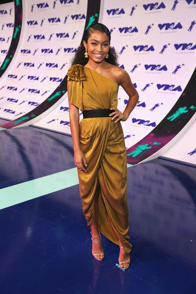 <p>Yara Shahidi channeled a Grecian goddess in a gold one-shoulder gown. (Photo: Getty Images) </p>