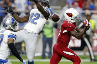 Detroit Lions strong safety James Ihedigbo (32) breaks up a pass intended for Arizona Cardinals wide receiver John Brown (12) during the second half of an NFL football game, Sunday, Nov. 16, 2014, in Glendale, Ariz. (AP Photo/Ross D. Franklin)