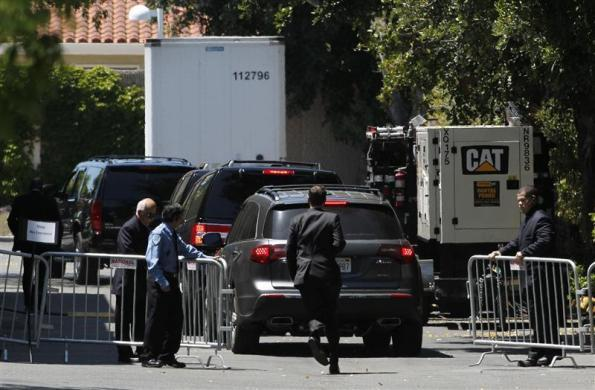 A convoy of SUVs is allowed past barricades before a Facebook Roadshow at the Crowne Plaza Hotel in the Palo Alto, May 11, 2012.