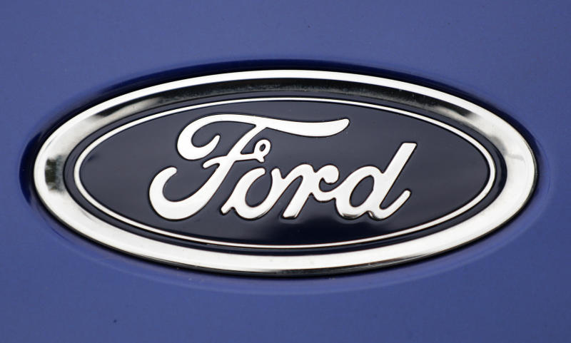 "FILE - In this Tuesday, Aug. 22, 2017 file photo, a Ford emblem is seen on a car at a store in London. Ford Motor Co. says it is cutting jobs in Europe in a wide-ranging restructuring as it focuses on its most profitable models and shifts production towards electric cars. In a statement, the company said Thursday, Jan. 10, 2019 that ""structural cost improvements will be supported by a reduction of surplus labor,"" both hourly and salaried. (AP Photo/Frank Augstein, File)"