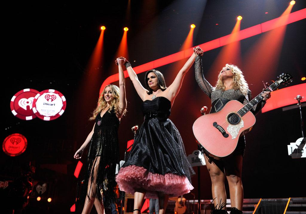 LAS VEGAS, NV - SEPTEMBER 21:  Miranda Lambert and the Pistol Annies  perform onstage during the 2012 iHeartRadio Music Festival at MGM Grand Garden Arena on September 21, 2012 in Las Vegas, Nevada.  (Photo by Kevin Mazur/WireImage)