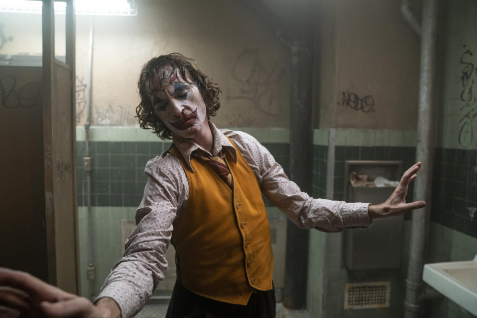 """This image released by Warner Bros. Pictures shows Joaquin Phoenix in a scene from """"Joker.""""  The film was named one of the American Film Institute's top 10 movies of the year. (Niko Tavernise/Warner Bros. Pictures via AP)"""
