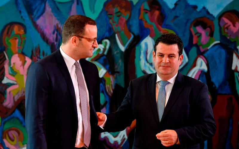 German Health Minister Jens Spahn (L) and German Labour Minister Hubertus Heil arrive for the weekly cabinet meeting in Berlin on June 27, 2018. / AFP PHOTO / John MACDOUGALLJOHN MACDOUGALL/AFP/Getty Images - JOHN MACDOUGALL/AFP