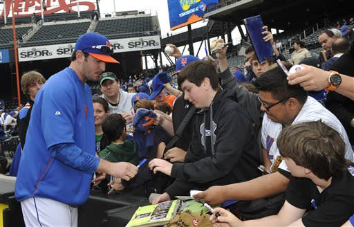 Fans crowd together to receive an autograph from New York Mets pitcher Matt Harvey before a baseball game against the Pittsburgh Pirates at Citi Field on Saturday, May 11, 2013 in New York. (AP Photo/Kathy Kmonicek)