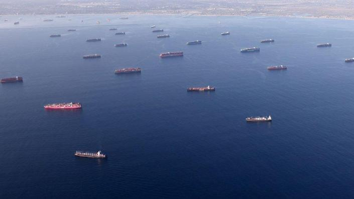 container ships are anchored by the ports of Long Beach and Los Angeles