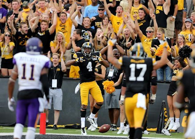 Iowa wide receiver Tevaun Smith, center, celebrates after a touchdown catch during the second half of an NCAA college football game against Northern Iowa, Saturday, Aug. 30, 2014, in Iowa City, Iowa. Iowa won 31-23. (AP Photo/Justin Hayworth)