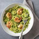 <p>Cut some carbs and use spiralized zucchini in place of noodles in this zesty pesto pasta dish recipe. Top with Cajun-seasoned shrimp to complete this quick and easy dinner.</p>
