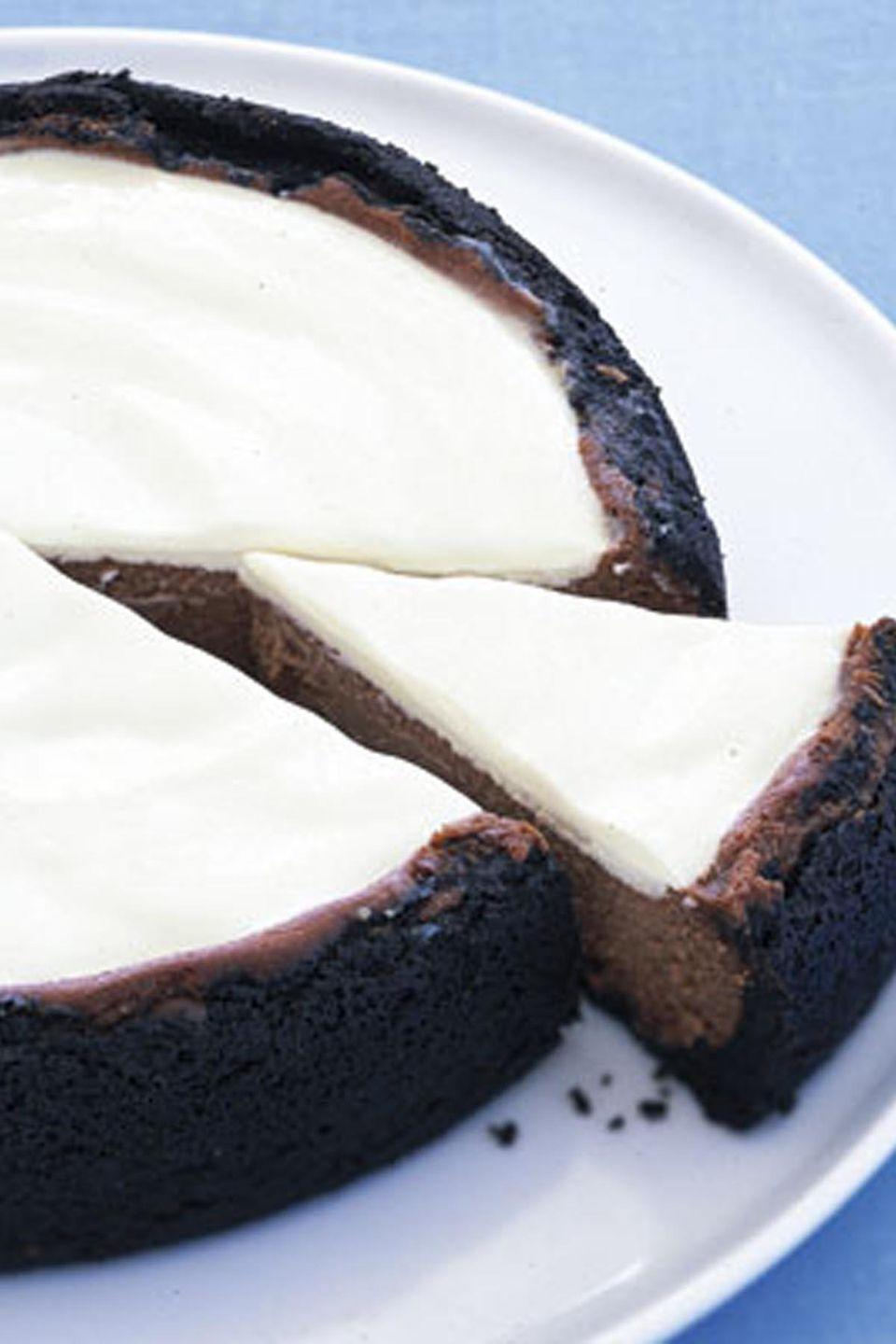 "<p>To make this classic cheesecake even creamier, add milk chocolate with a dark cookie crust, just for fun.</p><p><strong><a href=""https://www.countryliving.com/food-drinks/recipes/a6848/milk-chocolate-cheesecake-ghk1206/"" rel=""nofollow noopener"" target=""_blank"" data-ylk=""slk:Get the recipe"" class=""link rapid-noclick-resp"">Get the recipe</a>.</strong></p>"