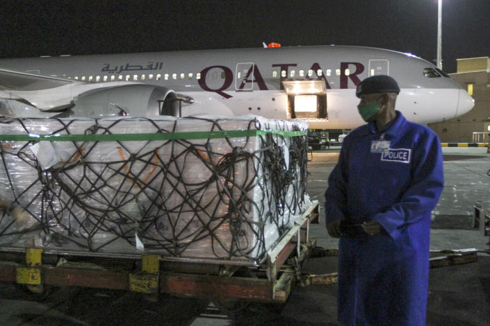The first arrival of COVID-19 vaccines to Kenya is offloaded from a Qatar Airways flight at Jomo Kenyatta International Airport in Nairobi, Kenya, early Wednesday, March 3, 2021. Around 1.02 million doses of the AstraZeneca COVID-19 vaccine manufactured by the Serum Institute of India arrived at the airport as part of the COVAX facility, according to the Ministry of Health. (AP Photo)