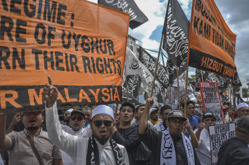 Protesters march while holding placards during a protest held in solidarity with the Uighur community in China, in Kuala Lumpur December 27, 2019. — Picture by Shafwan Zaidon