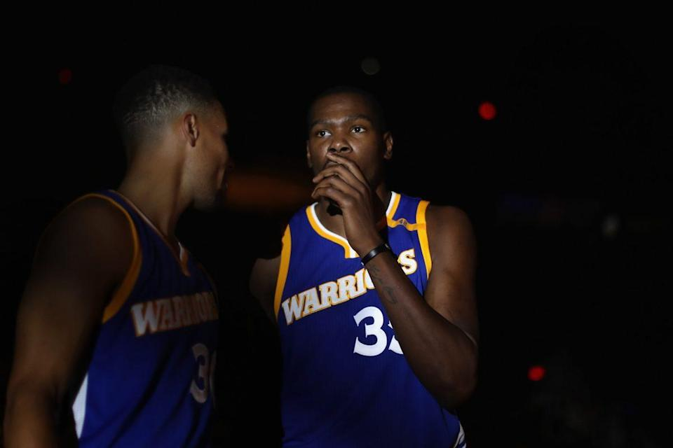 Golden State and members of Kevin Durant's inner circle are fearful that the knee injury he suffered Tuesday against Washington could keep him out until the start of the playoffs, and maybe even longer. (Getty)
