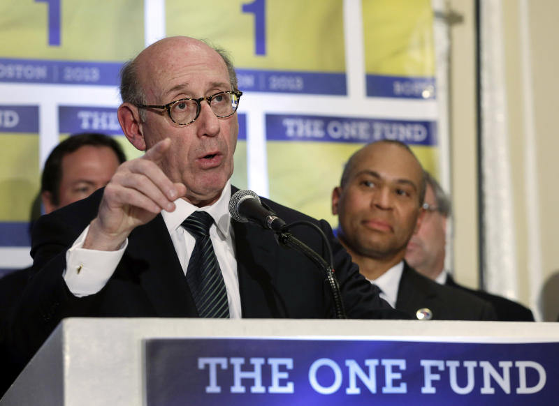 FILE - In this April 23, 2013 file photo, Kenneth Feinberg, an attorney who managed the 9/11 Victim Compensation Fund, speaks at a news conference in Boston as Massachusetts Gov. Deval Patrick, right, listens. The One Fund was established by Patrick and Boston Mayor Thomas Menino as a central place to gather donations for the Boston Marathon bombing victims. While giving is the reliable flip side to tragic events, charity watchdog groups recommend seeking out well-established charities or credibly backed efforts like The One Fund. (AP Photo/Elise Amendola, File)