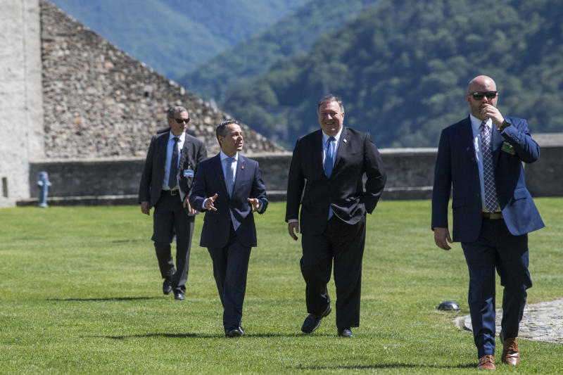 U.S. Secretary of State Mike Pompeo, center right, and Swiss Foreign Minister Ignazio Cassis, center left, talk during Pompeo's visit at the CastelGrande in Bellinzona, Switzerland, Sunday, 2 June 2019. (Samuel Golay/Keystone via AP)