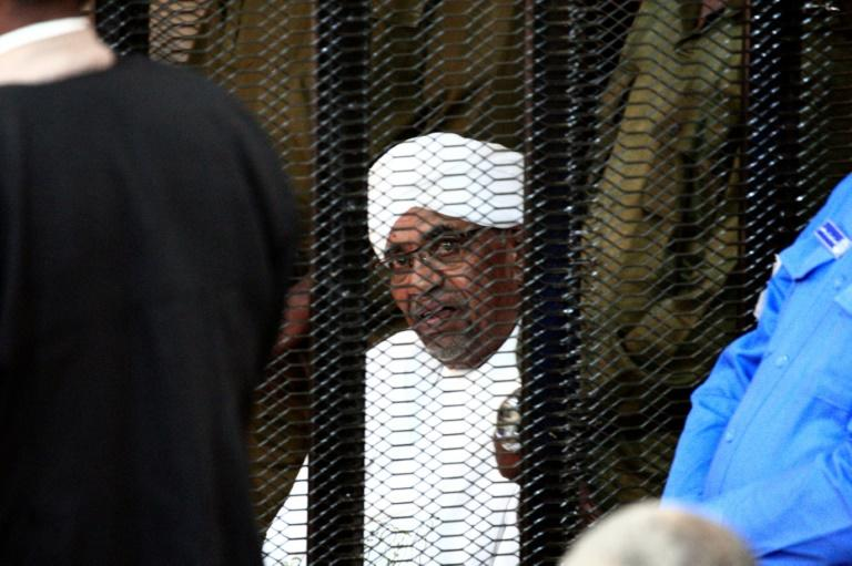 Sudan's deposed military ruler Omar al-Bashir sits in a defendant's cage during his corruption trial in Khartoum, pictured in August (AFP Photo/Ebrahim HAMID)