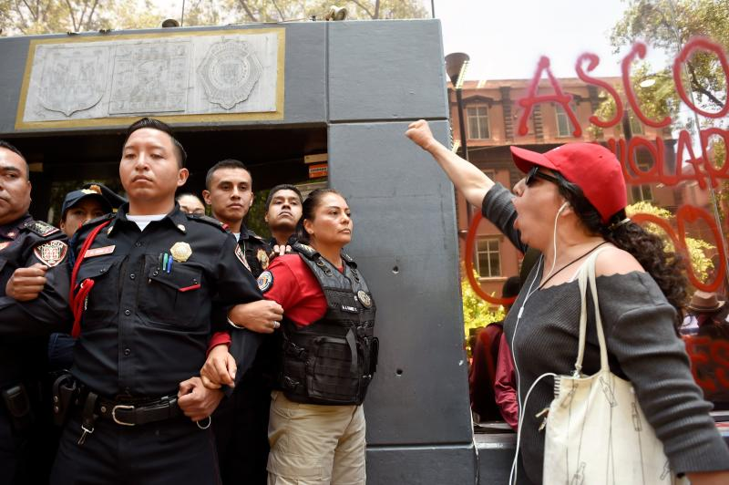 A woman shouts slogans during a protest called by civil organizations against the police, after four police officers had been accused of raping a minor las t weekend in their patrol car in the Azcapotzalco neighborhood, in front of the Ministry of Public Security in Mexico City on August 12, 2019. (Photo by ALFREDO ESTRELLA / AFP) (Photo credit should read ALFREDO ESTRELLA/AFP/Getty Images)
