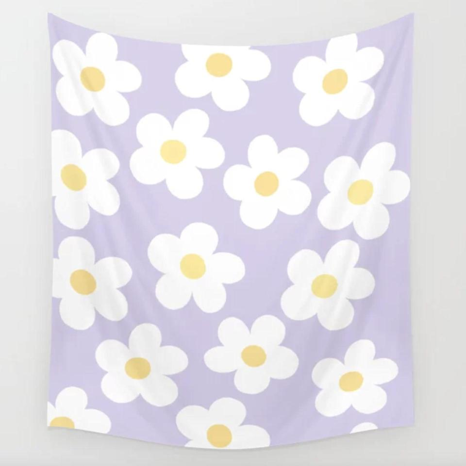 <p>Hang this <span>Lobbygirl 70's Retro Flower Power Wall Tapestry</span> ($27, originally $45) behind your bed and use it like a headboard.</p>