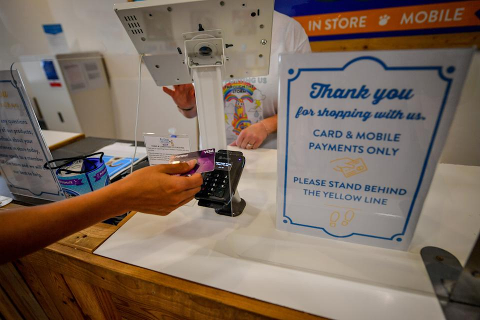 Contactless payment behind a plastic screen in a shop in Bristol as non-essential shops in England open their doors to customers for the first time since coronavirus lockdown restrictions were imposed in March. (Photo by Ben Birchall/PA Images via Getty Images)