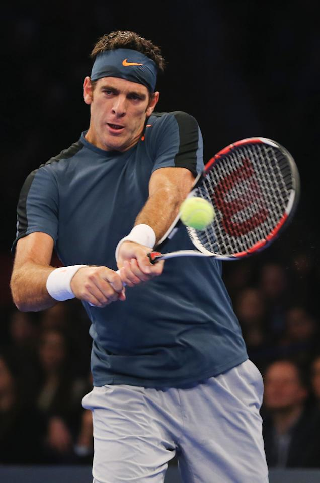 NEW YORK, NY - MARCH 04:  Juan del Potro of Argentina returns a shot to Rafael Nadal of Spain during the BNP Paribas Showdown on March 4, 2013 at Madison Square Garden in New York City.  (Photo by Elsa/Getty Images)