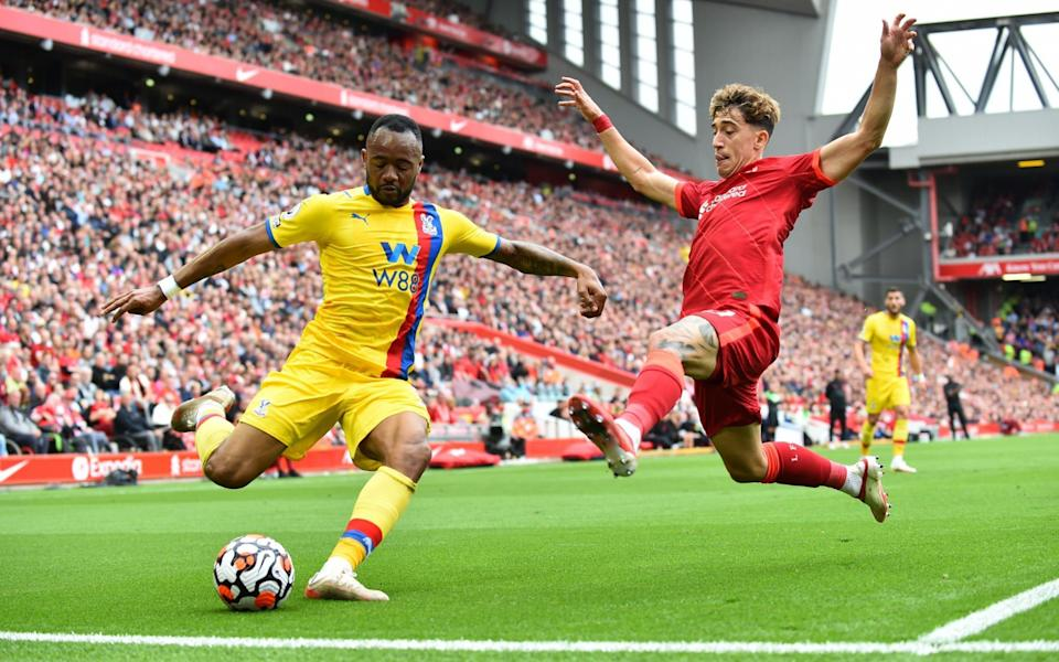 Crystal Palace's Jordan Ayew in action with Liverpool's Kostas Tsimikas - Reuters