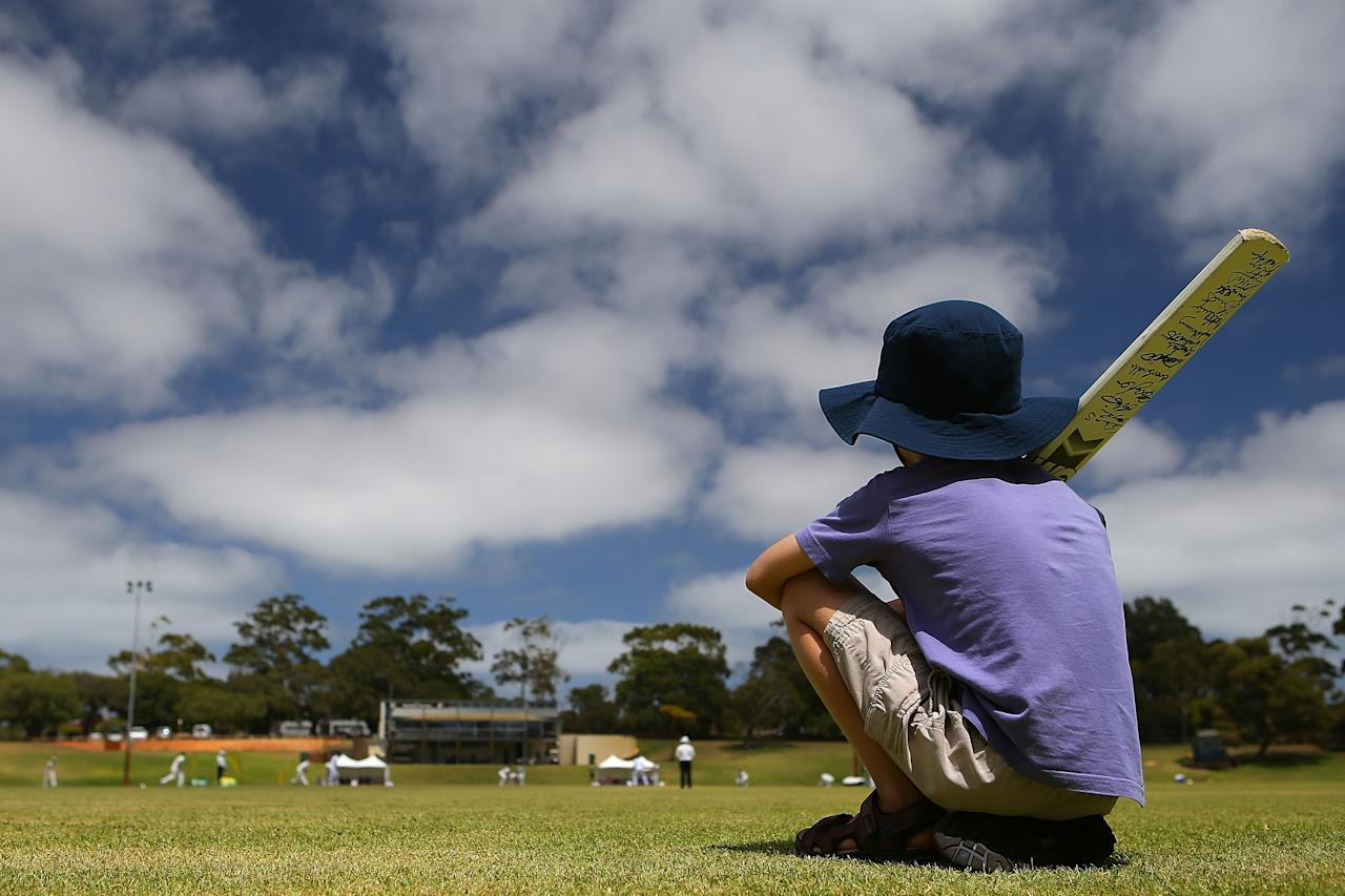 PERTH, AUSTRALIA - JANUARY 07: (EDITORS NOTE: A polarizing filter was used for this image.)  A young boy watches the action from the boundary during day two of the women's tour match between Australia Shooting Stars and England at Floreat Oval on January 7, 2014 in Perth, Australia.  (Photo by Paul Kane/Getty Images)