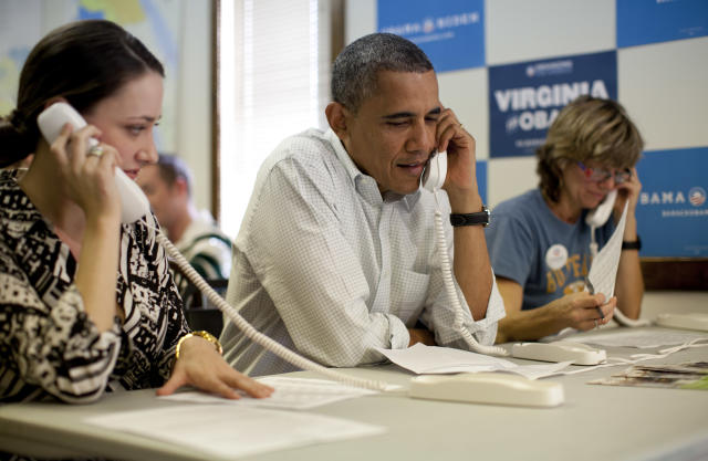 President Barack Obama makes phone calls to volunteers at an Organizing for America field office in 2012. (Photo: Carolyn Kaster/AP)