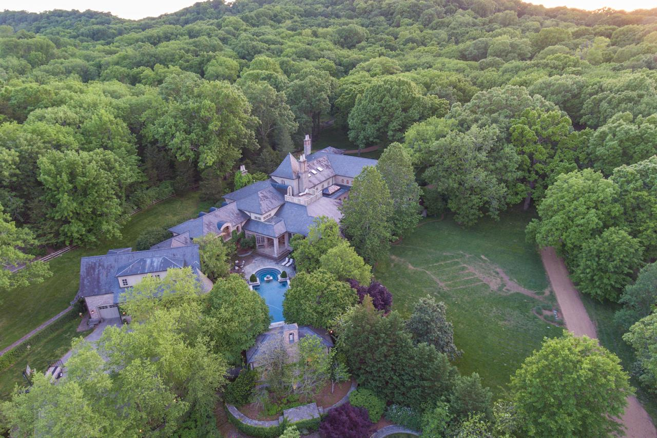 The property sits on six acres of land. It has a three-car garage and parking for approximately 300 guest cars. (The Agency)