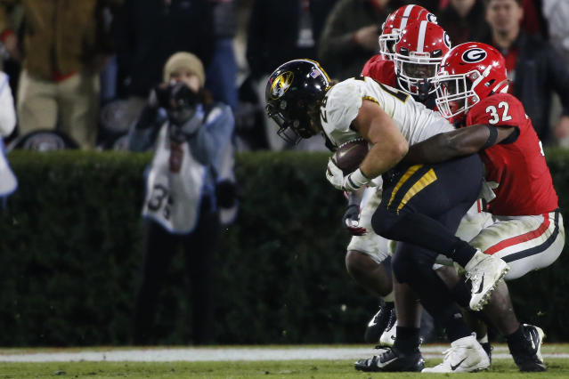 Georgia inside linebacker Monty Rice (32) stops Missouri running back Dawson Downing (28) at the goal line during the second half of an NCAA college football game Saturday, Nov. 9, 2019, in Athens, Ga. (Joshua L. Jones/Athens Banner-Herald via AP)