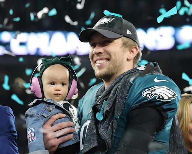 Philadelphia Eagles quarterback Nick Foles (9) celebrates with his daughter Lily after defeating the New England Patriots in Super Bowl LII at U.S. Bank Stadium. Mandatory Credit: Winslow Townson-USA TODAY Sports