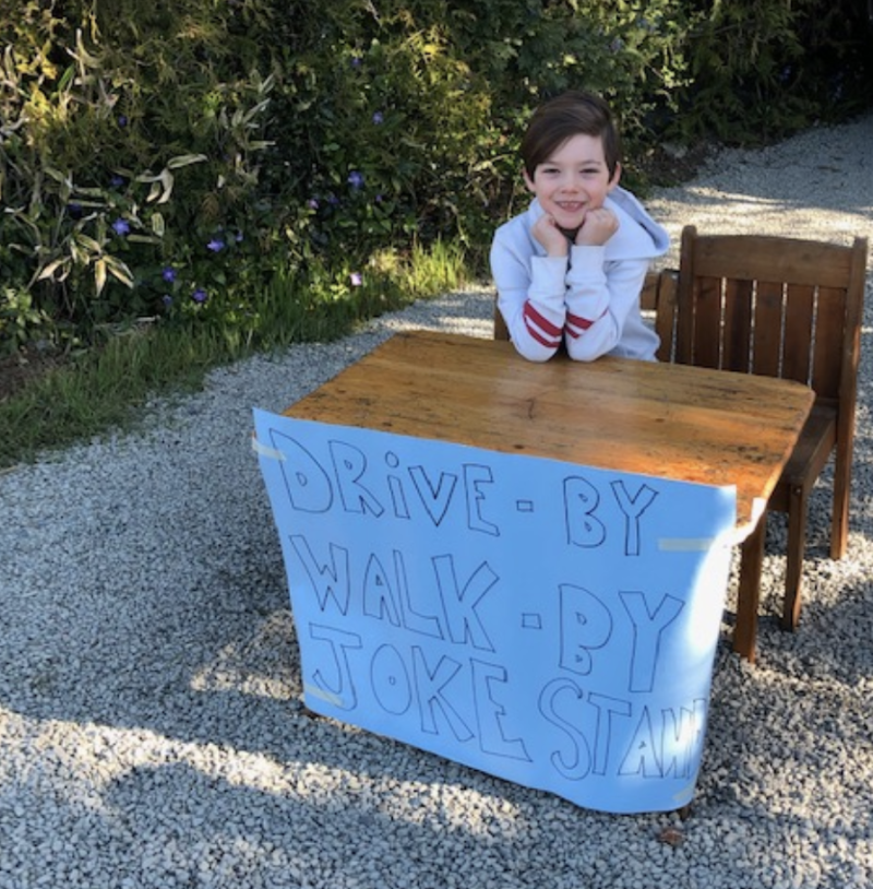 Callaghan, 6, is entertaining the neighbors with his drive-by joke stand. (Photo: Courtesy Kelsea McLaughlin)
