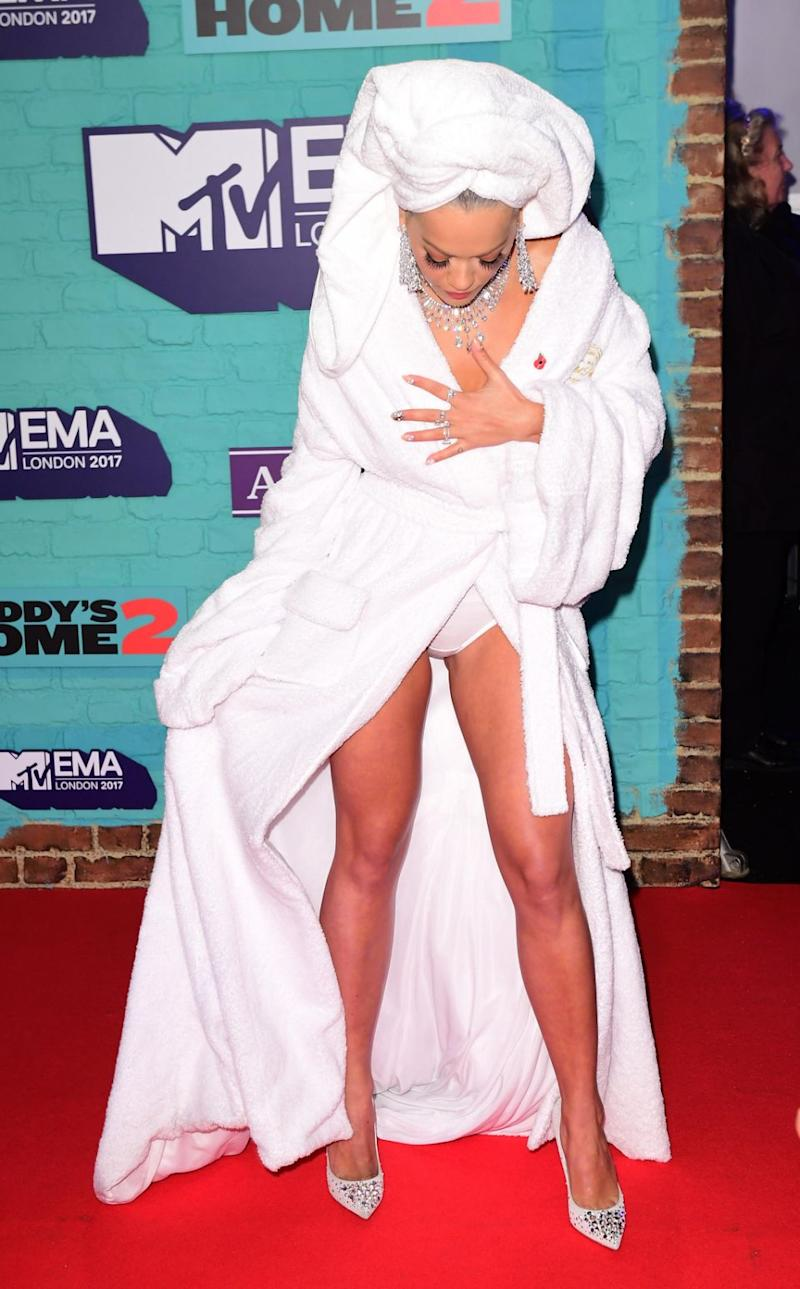 Rita accidentally flashed waiting photographers in her daring bathrobe. Source: Getty