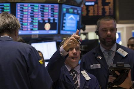 A trader gives a thumbs up while he works on the floor of the New York Stock Exchange February 3, 2014. REUTERS/Brendan McDermid