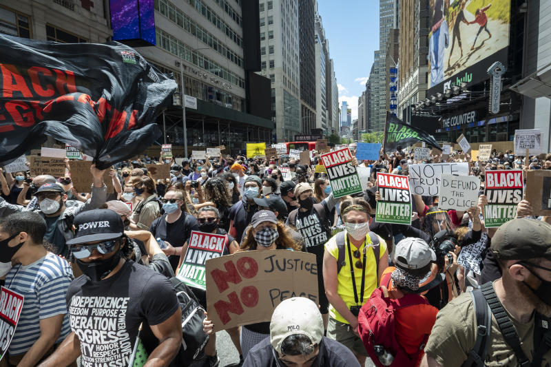 """MANHATTAN, NY - JUNE 07: Thousands of protesters wearing masks and holding signs crowd into Times Square to support Black Lives Matter. This was part of the Black Lives Matter New York (BLMNY) protest that offered a Blueprint for change and called on New York state legislators and members of Congress to end the slaughter of Black persons by the very institutions charged with protecting them. The Blueprint is a policy platform to reform failed statutes and regulations and to begin reforming to a more civil and just society. This includes the I Can't Breathe Act, the Blue Wall Act, repealing of 50-A statute and includes housing and education reforms. Protesters keep taking to the streets across America and around the world after the killing of George Floyd at the hands of a white police officer Derek Chauvin that was kneeling on his neck during his arrest as he pleaded that he couldn't breathe. The protest are attempting to give a voice to the need for human rights for African American's and to stop police brutality against people of color. Many people were wearing masks and observing social distancing due to the coronavirus pandemic. Photographed in the Manhattan Borough of New York on June 07, 2020, USA. (Photo by Ira L. Black/Corbis via Getty Images)""""n""""n""""n"""