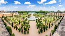 """<p>The lavish network of trimmed topiaries, storied fountains and sculptures, and fragrant flower beds at the <a href=""""http://en.chateauversailles.fr/"""" rel=""""nofollow noopener"""" target=""""_blank"""" data-ylk=""""slk:Palace of Versailles"""" class=""""link rapid-noclick-resp"""">Palace of Versailles </a>make up one of the most famous gardens in the world. King Louis XIV of France commissioned famous French landscape designer André Le Nôtre to renovate the <a href=""""http://en.chateauversailles.fr/discover/estate/gardens"""" rel=""""nofollow noopener"""" target=""""_blank"""" data-ylk=""""slk:gardens of Versailles"""" class=""""link rapid-noclick-resp"""">gardens of Versailles </a>in 1661 and became the crowning jewel of his reign. Every 100 years, the gardens needs to be replanted to maintain its youthful, flourishing appearance. </p>"""